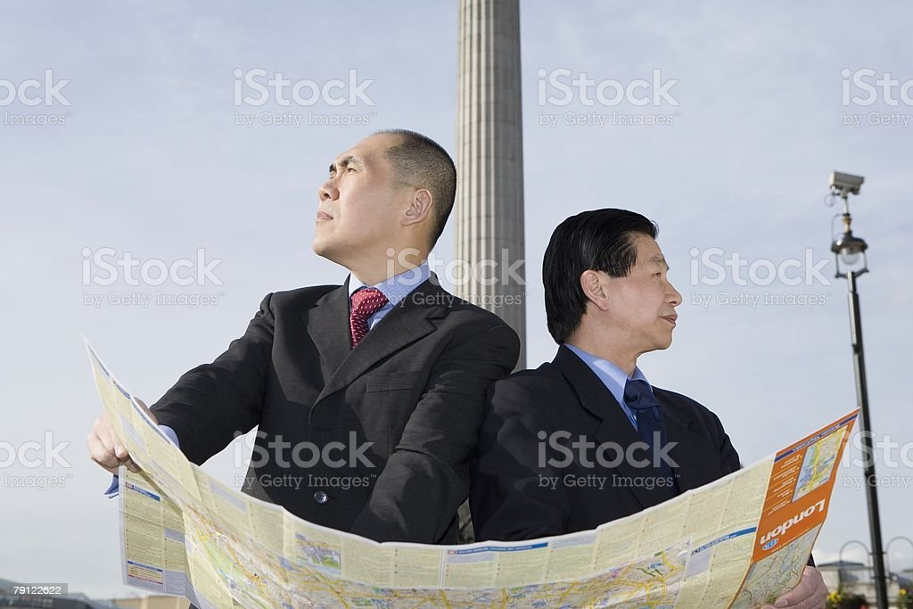 Businessmen with map royalty-free stock photo