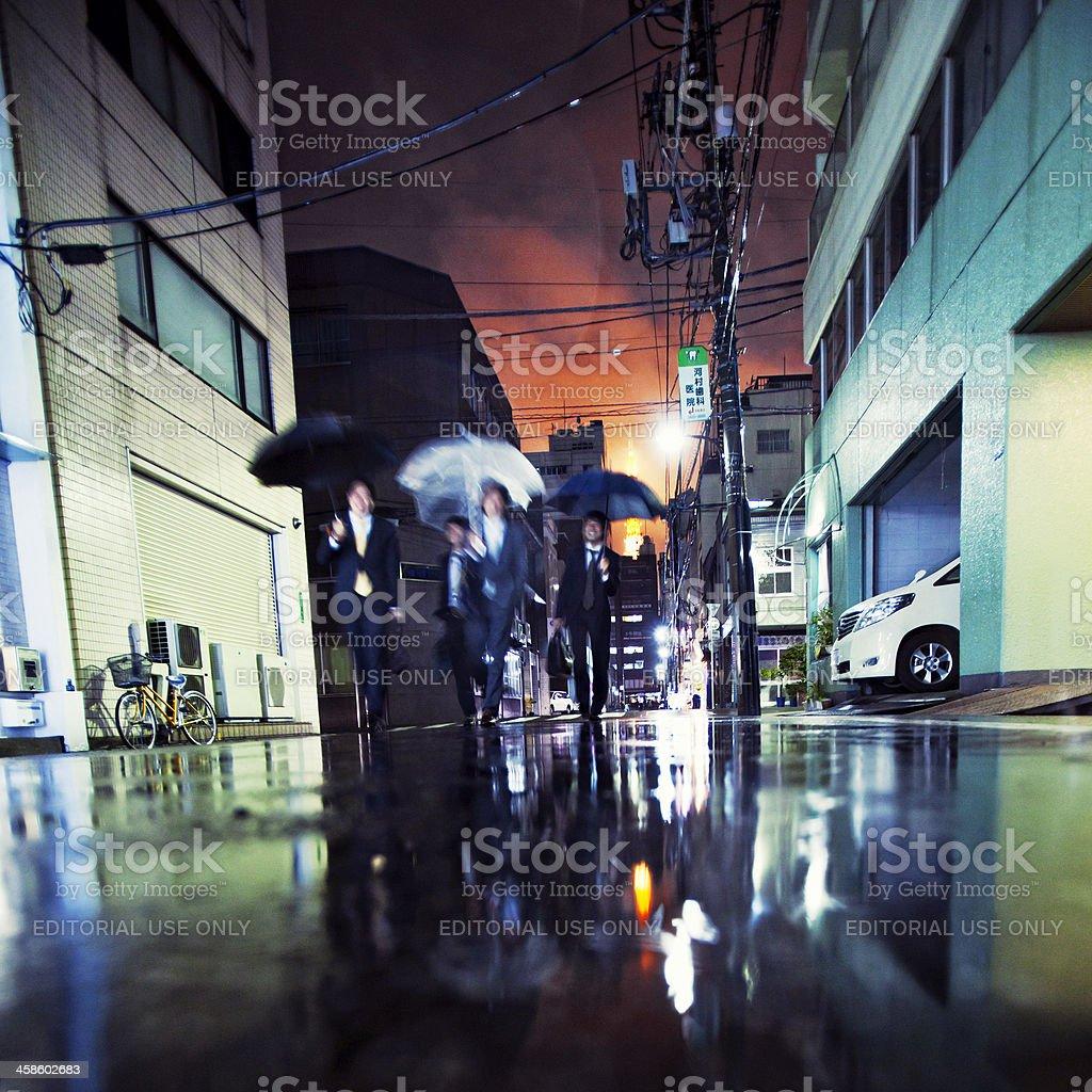 Businessmen with umbrellas stock photo