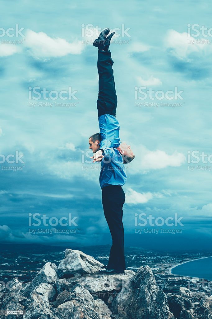 Businessmen work together in a creative way using their bodies stock photo