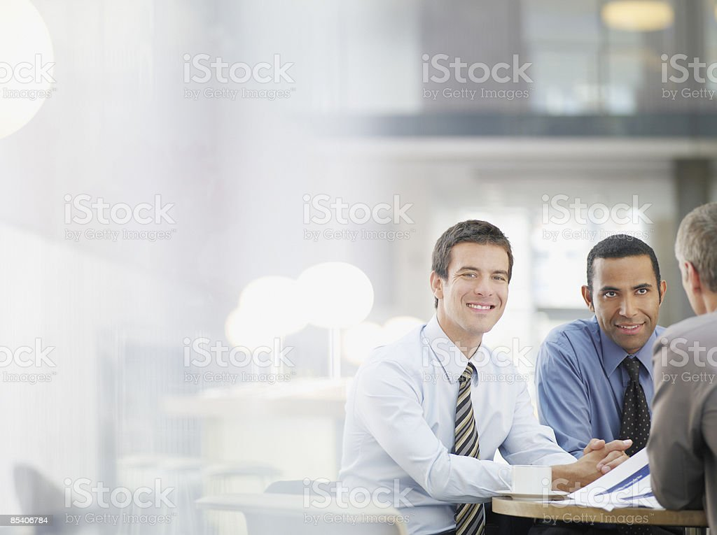Businessmen working in cafe royalty-free stock photo