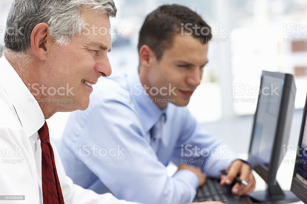 Businessmen working on computers royalty-free stock photo