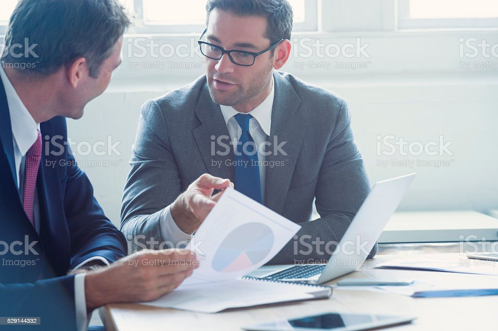 Businessmen working together on a document. stock photo