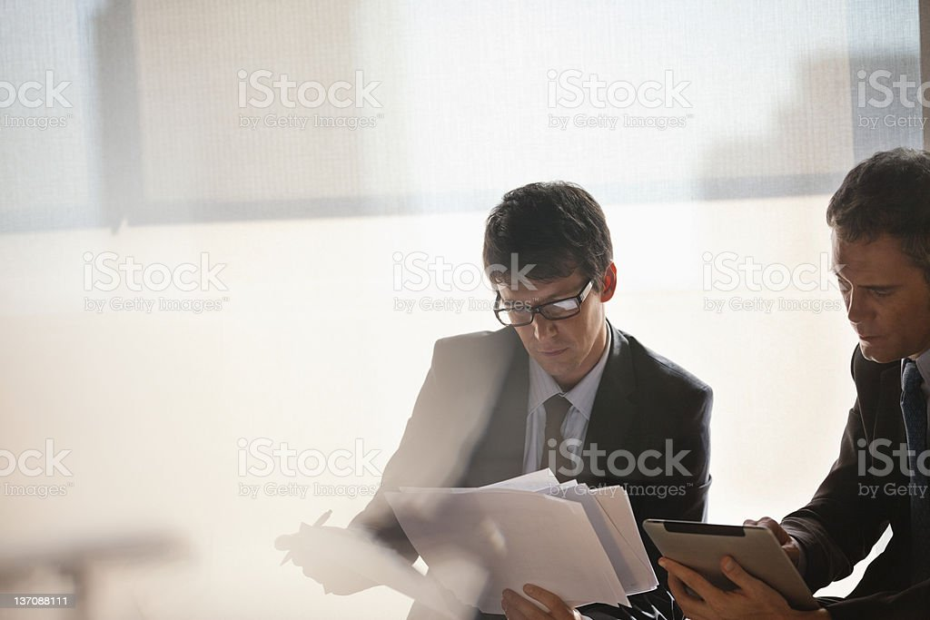 Businessmen working together stock photo