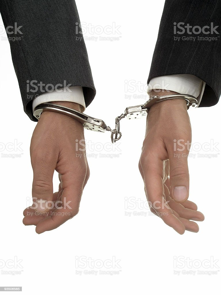 Businessmen's hands In Handcuffs royalty-free stock photo