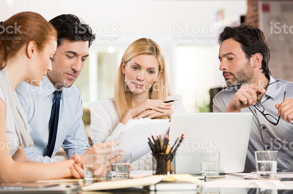Businesspeople analyzing documents stock photo