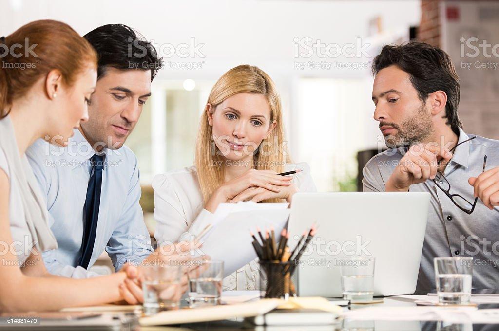 Businesspeople analyzing documents stock photo