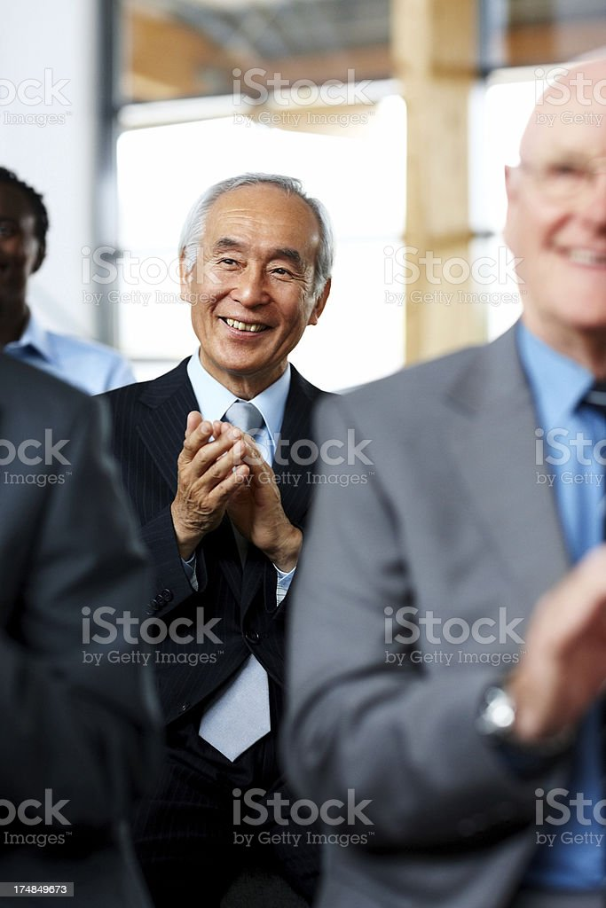 Businesspeople applauding a great presentation royalty-free stock photo