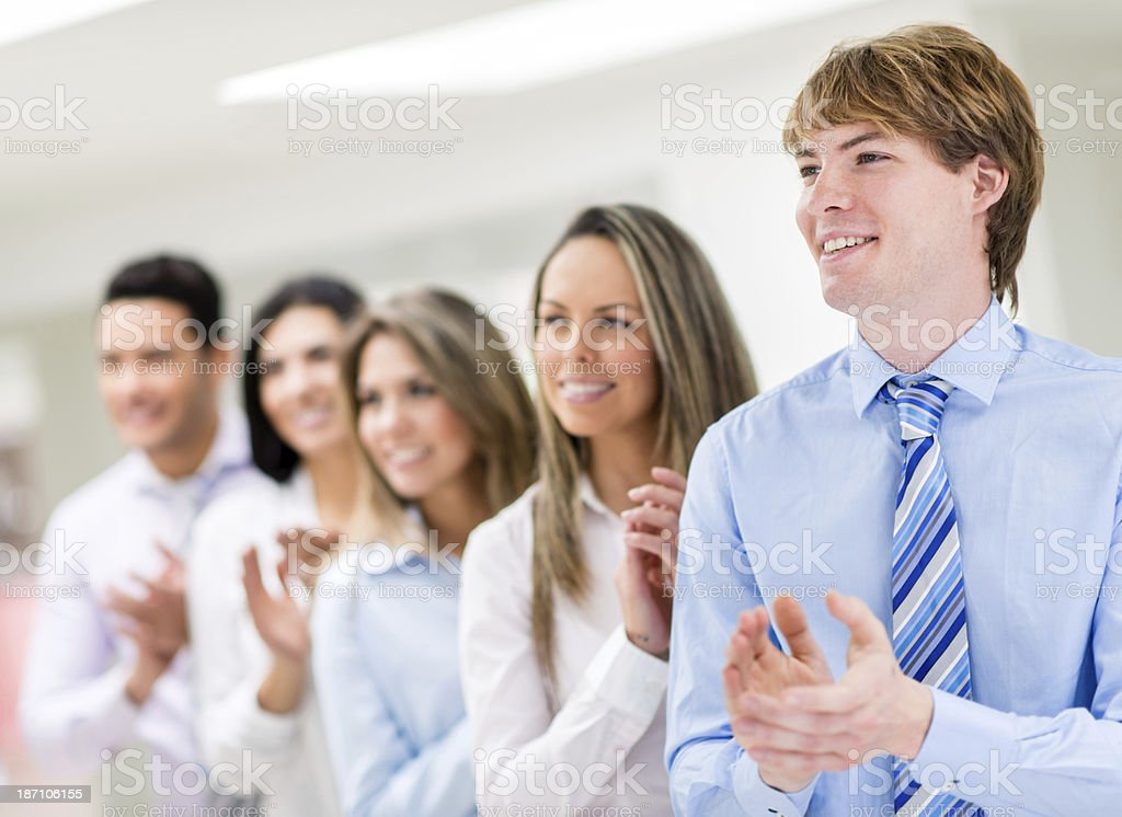 Businesspeople applauding after a meeting stock photo