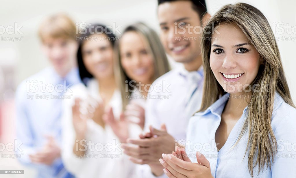 Businesspeople applauding after meeting stock photo