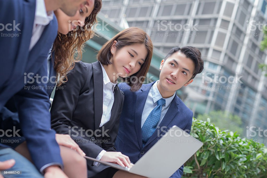businesspeople are looking tablet meeting stock photo