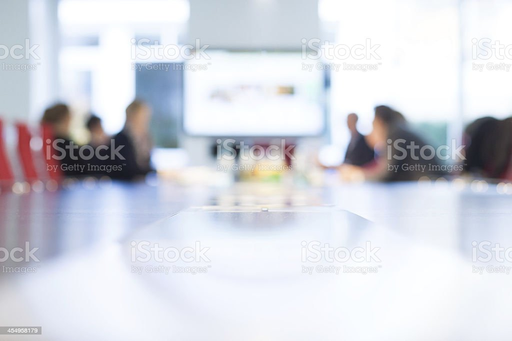 Businesspeople at a boardroom table stock photo