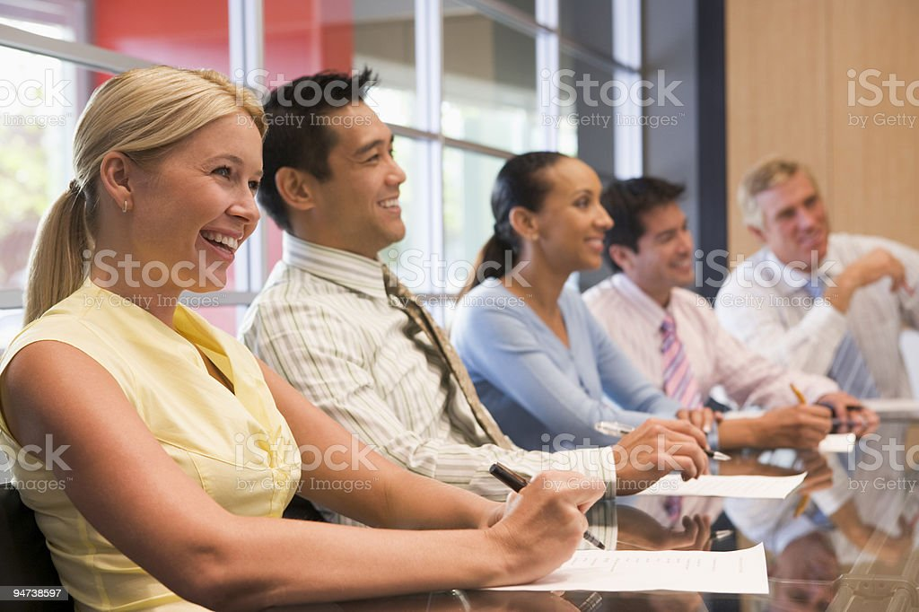 Businesspeople at boardroom table royalty-free stock photo