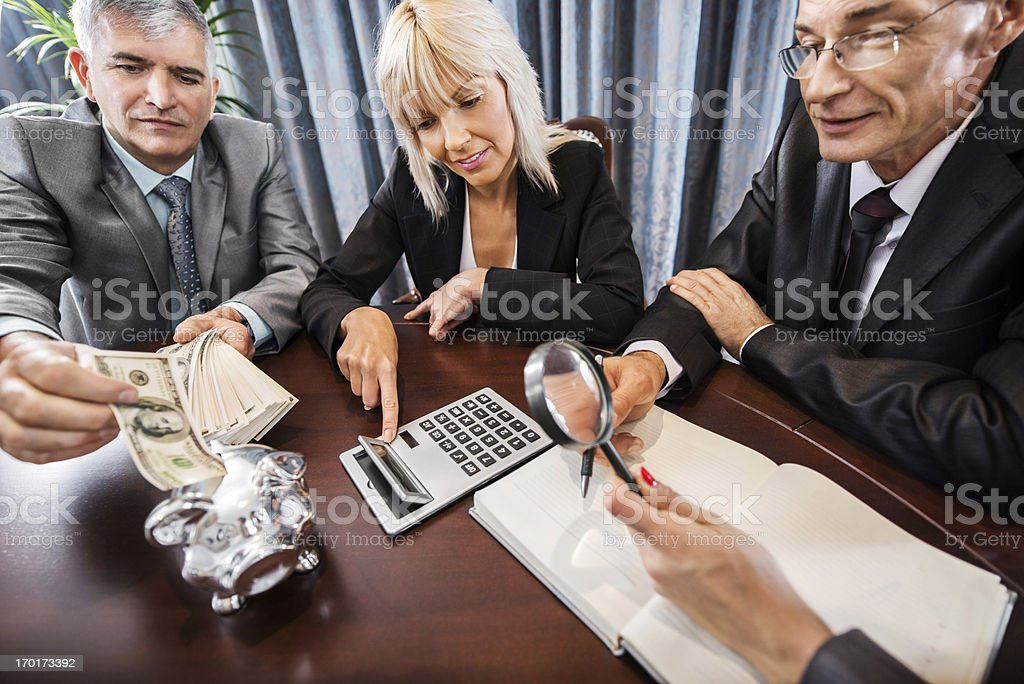 Businesspeople calculating. royalty-free stock photo