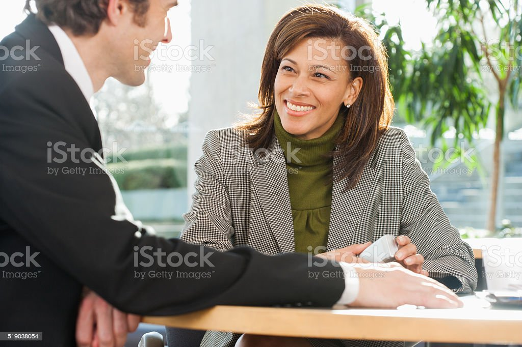 Businesspeople chatting in a cafe stock photo