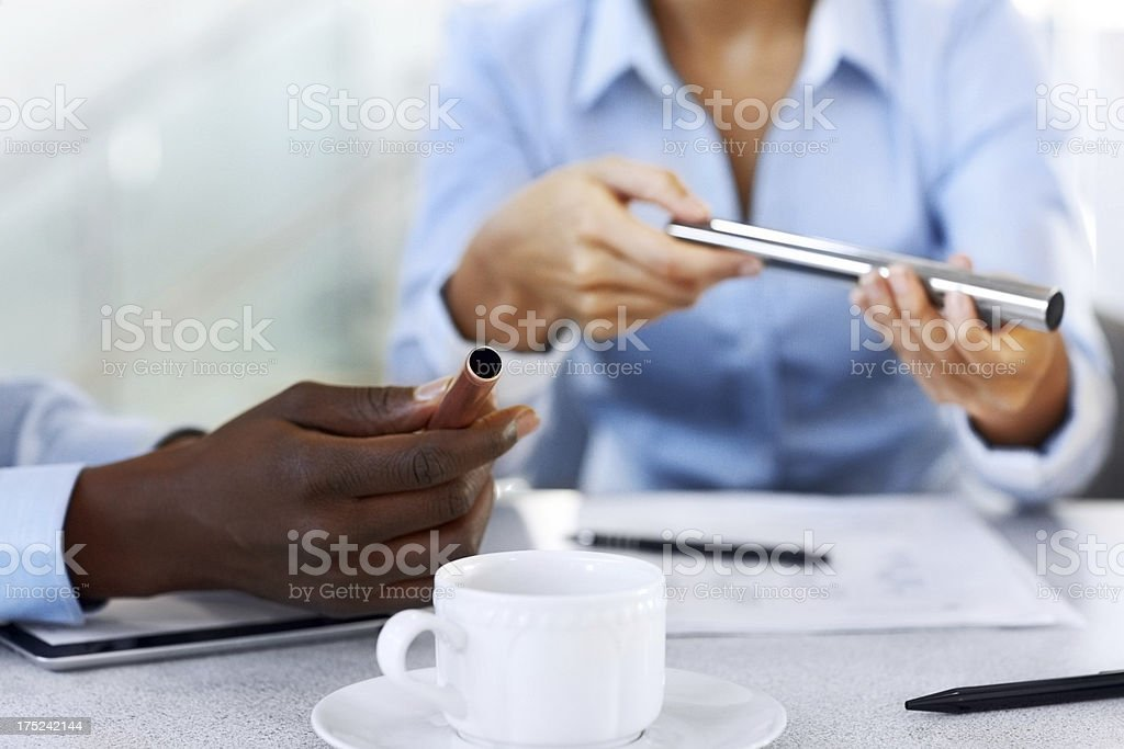 Businesspeople checking quality of metal tubes royalty-free stock photo