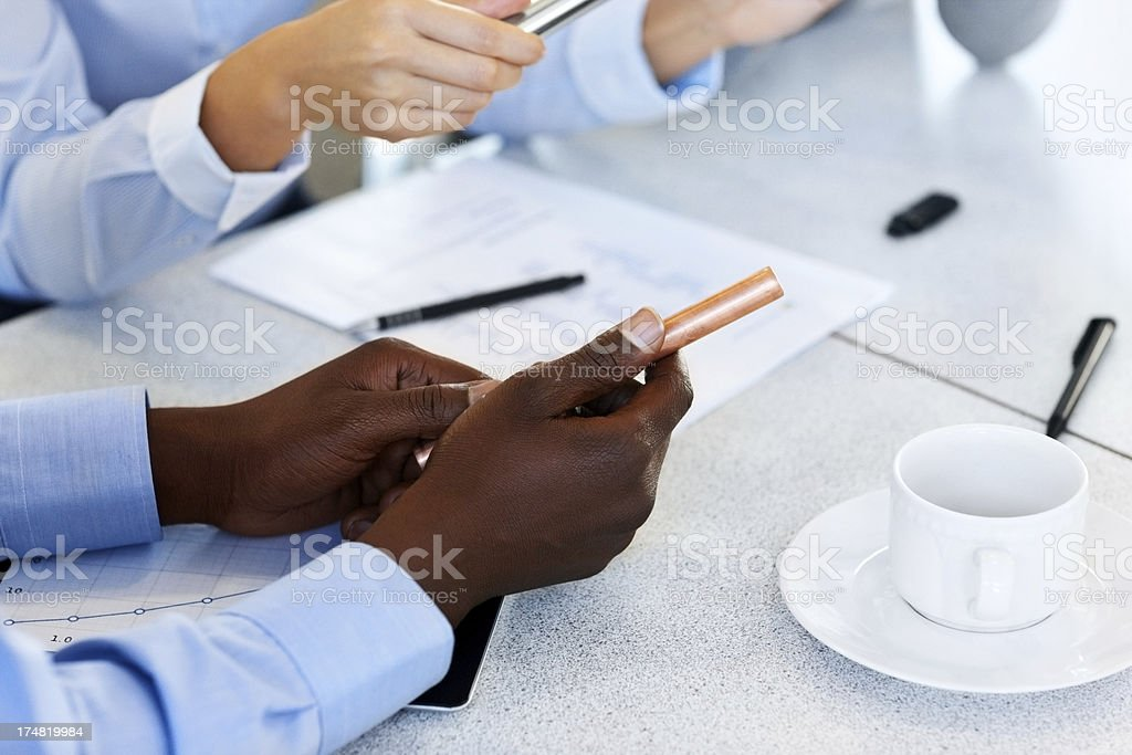 Businesspeople checking quality of raw material royalty-free stock photo
