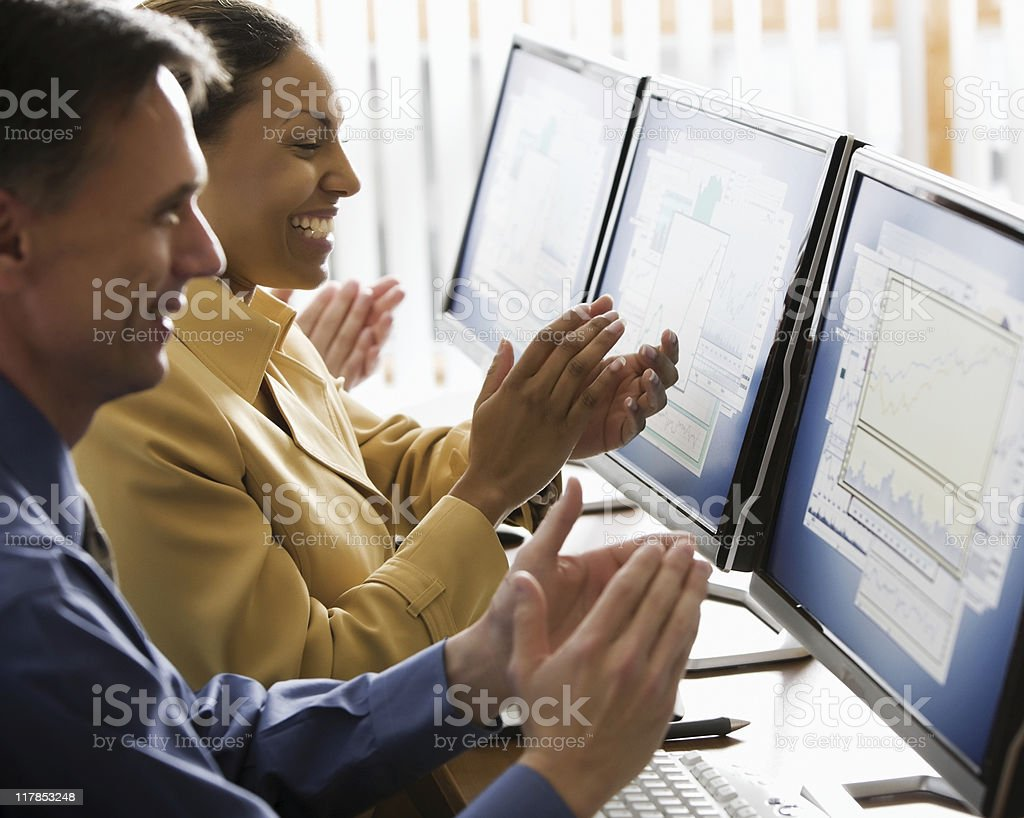 Businesspeople Clapping at Report on Monitors royalty-free stock photo