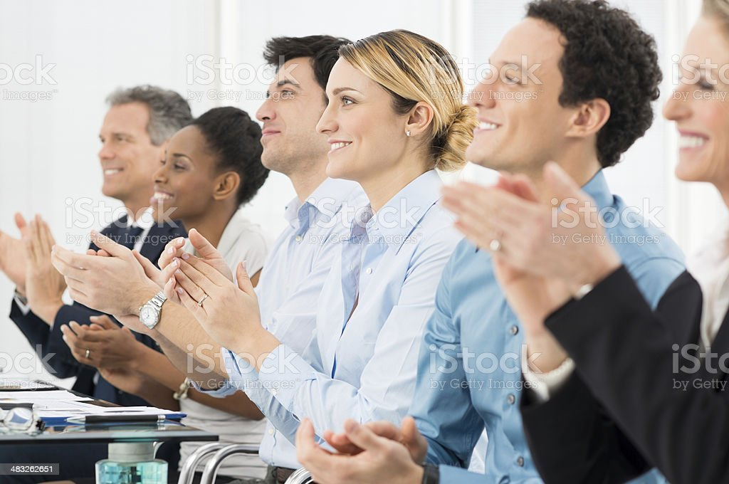 Businesspeople Clapping In Office royalty-free stock photo