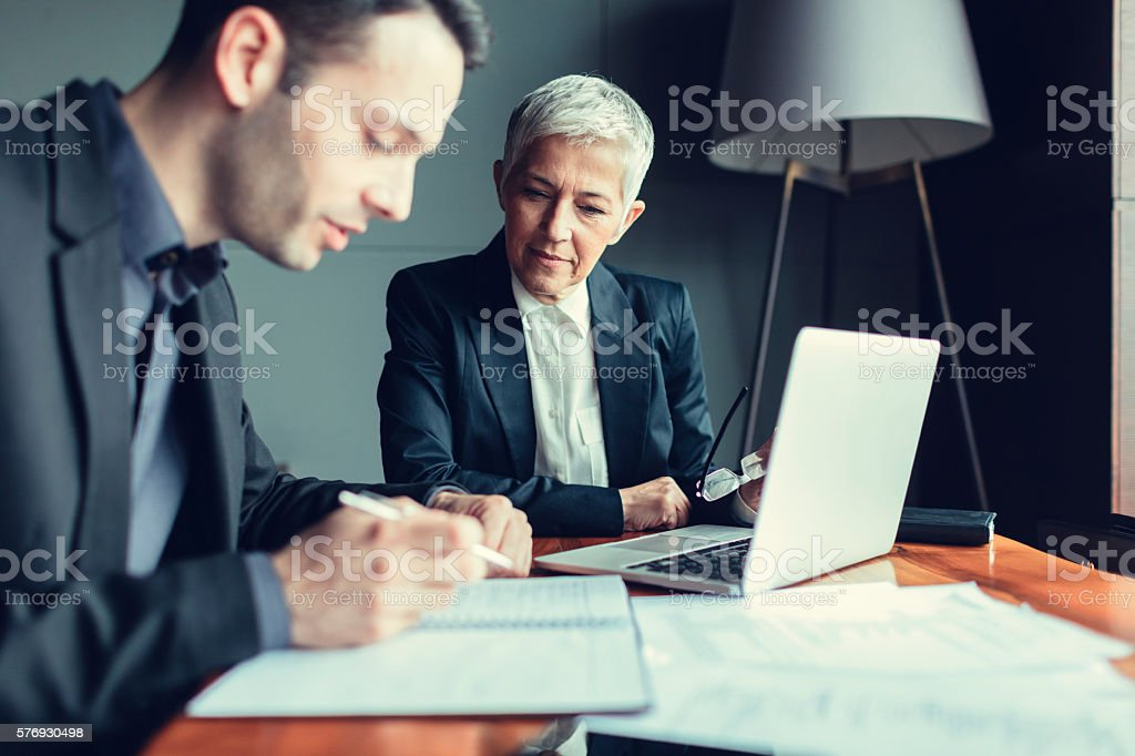 Businesspeople Collaborate In Their Office. stock photo