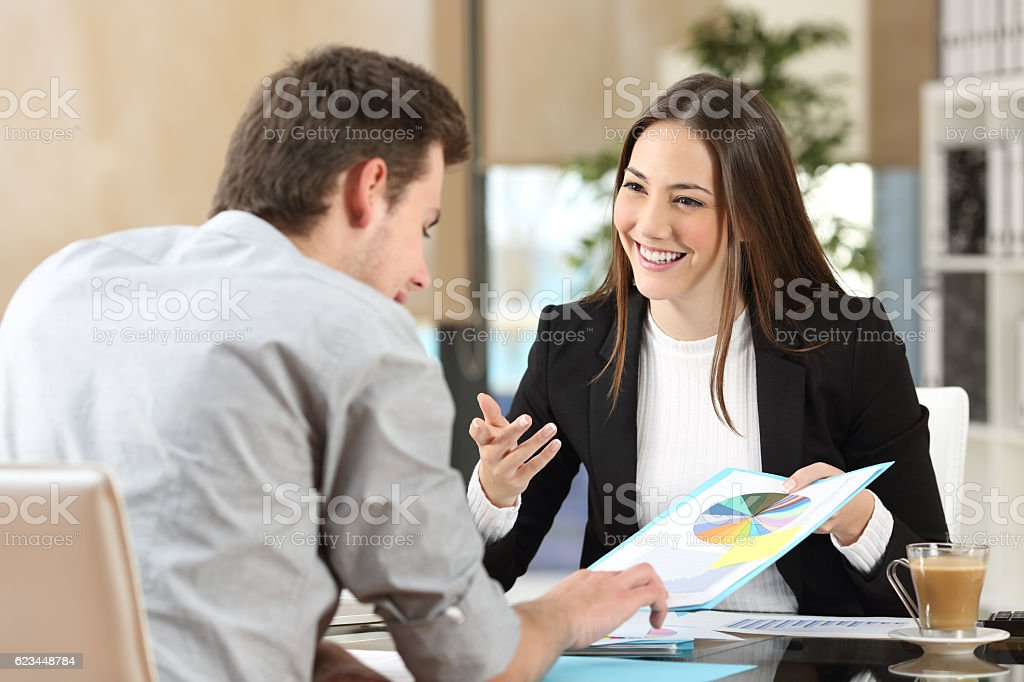 Businesspeople coworking showing growth graphic stock photo