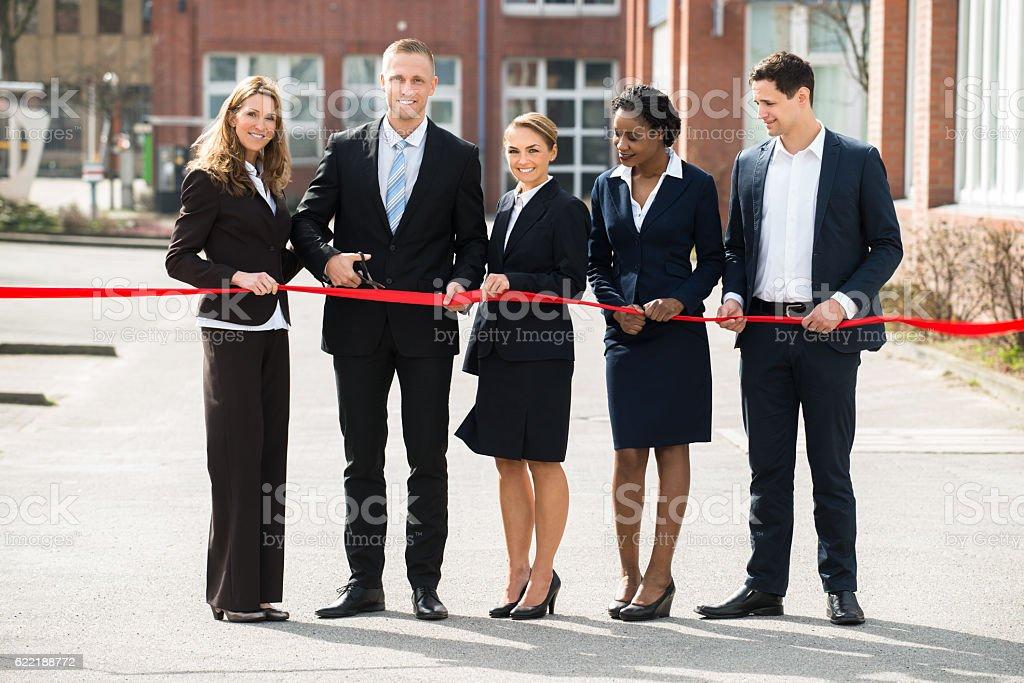 Businesspeople Cutting Ribbon stock photo