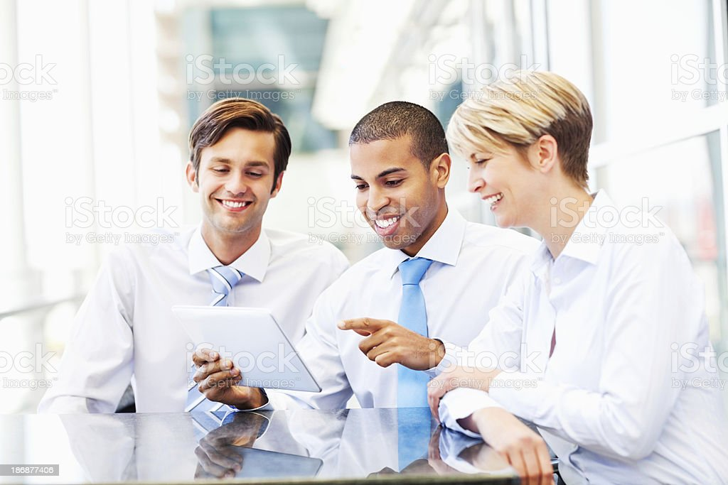 Businesspeople Discussing Project On Digital Tablet royalty-free stock photo