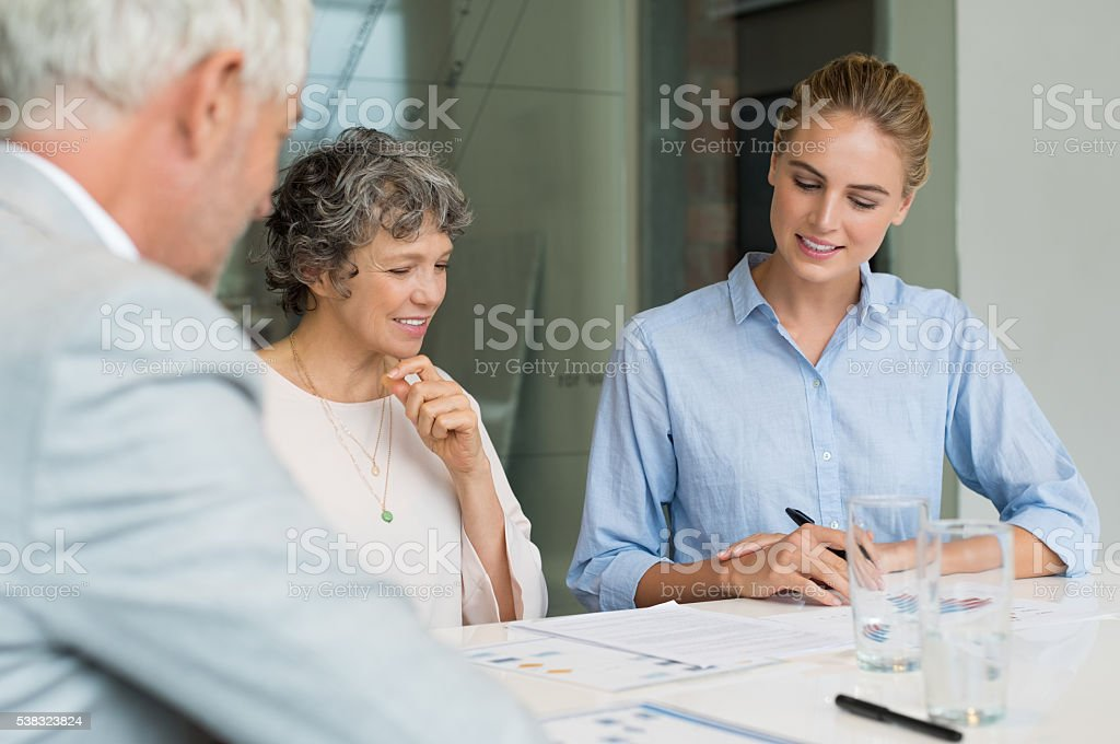 Businesspeople discussing project stock photo