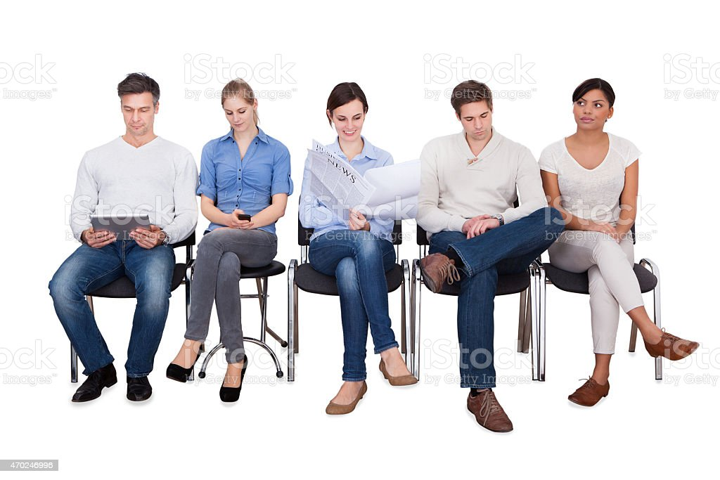 Businesspeople Doing Various Activities On Chairs stock photo