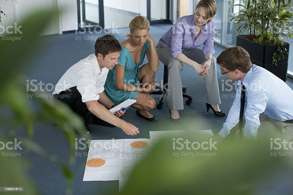 Businesspeople examining work in office royalty-free stock photo