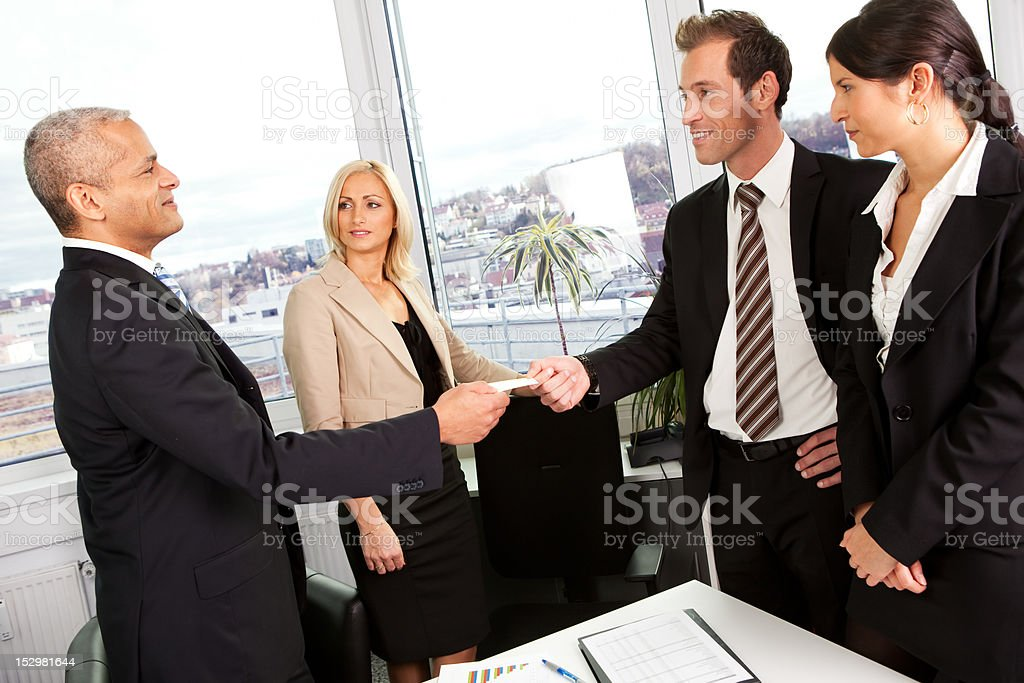 Businesspeople exchange business cards stock photo