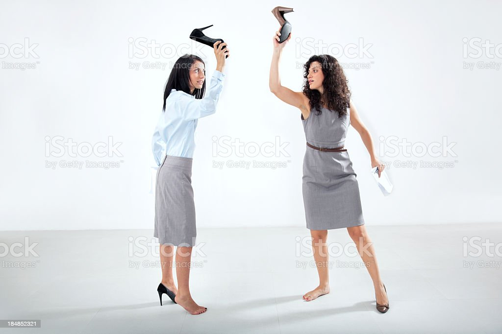 businesspeople fighting stock photo