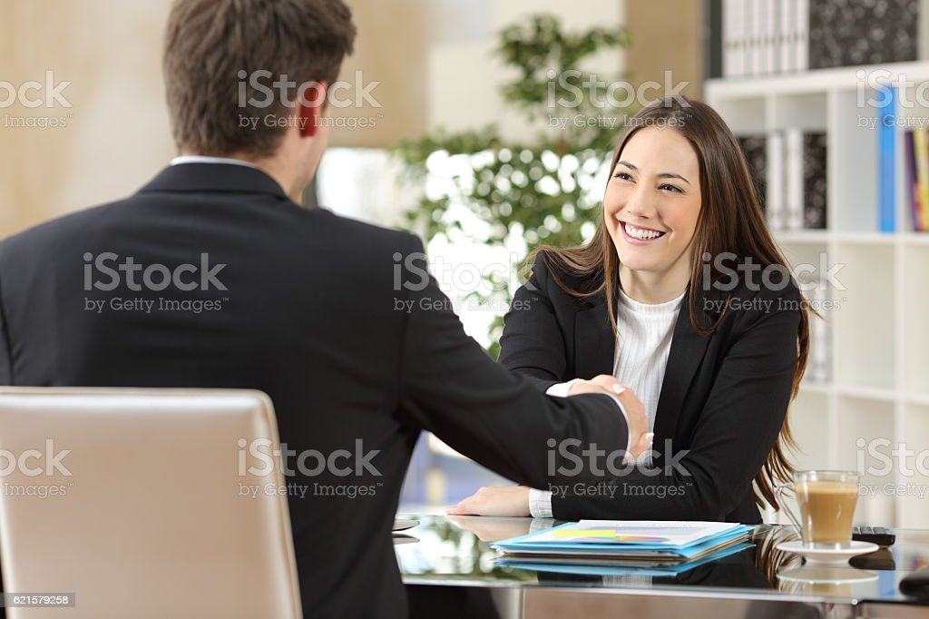 Businesspeople handshaking after negotiation stock photo