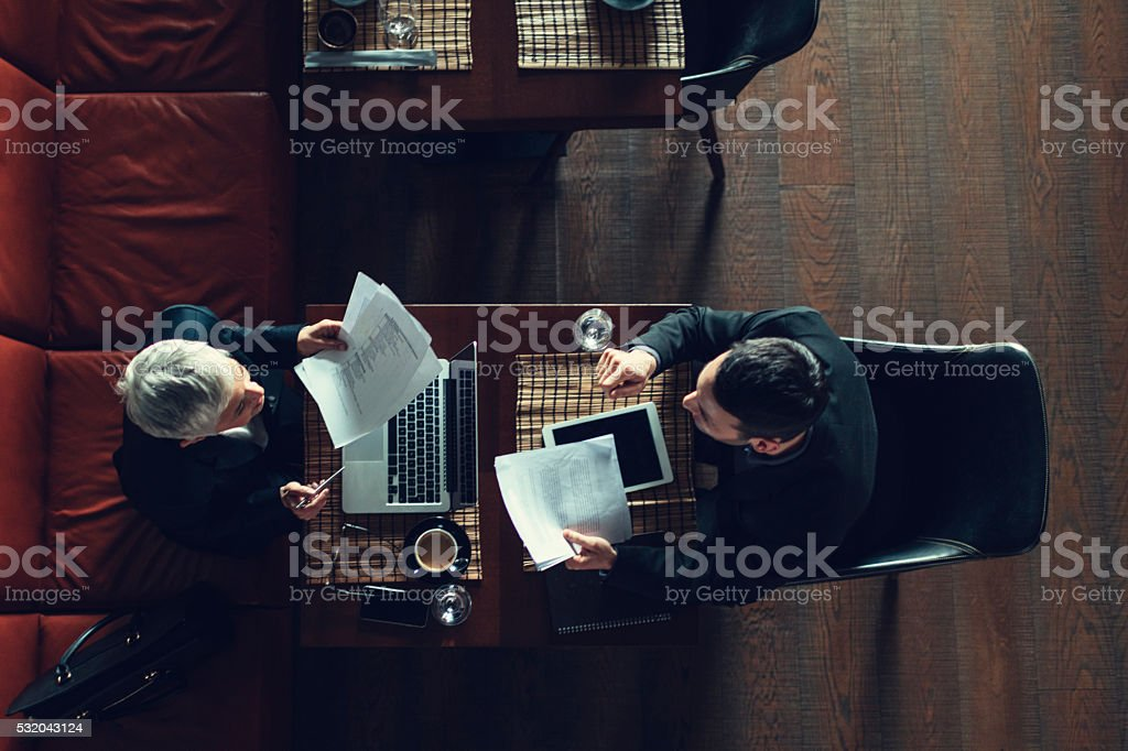 Businesspeople Have Meeting In Restaurant. stock photo
