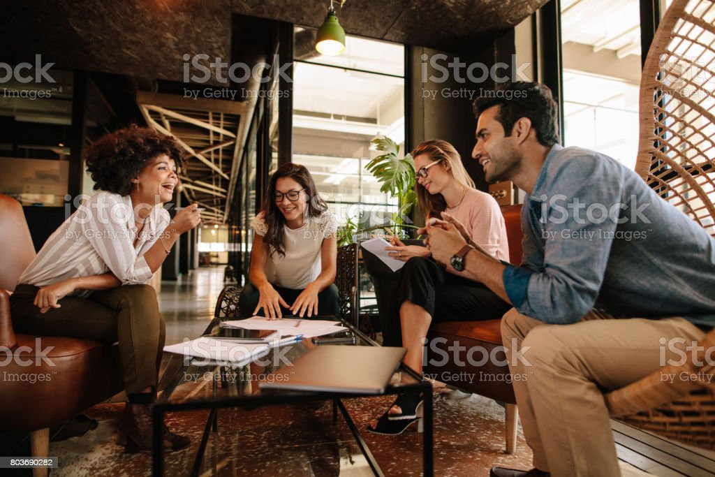 Businesspeople having a meeting in a modern office stock photo