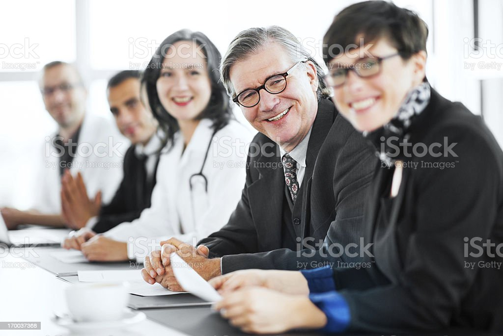 Businesspeople having a meeting with doctors. royalty-free stock photo