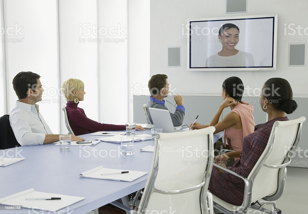 Businesspeople having a video conference stock photo