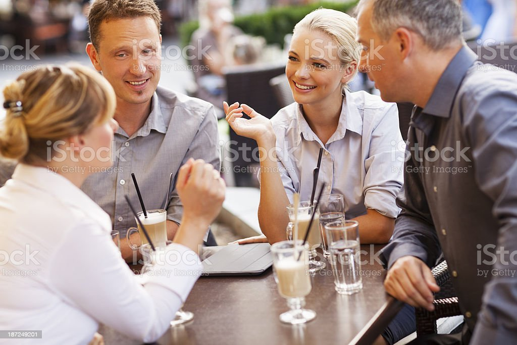 Businesspeople having coffee at sidewalk cafe royalty-free stock photo