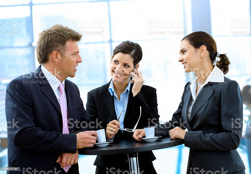 Businesspeople having coffee break stock photo