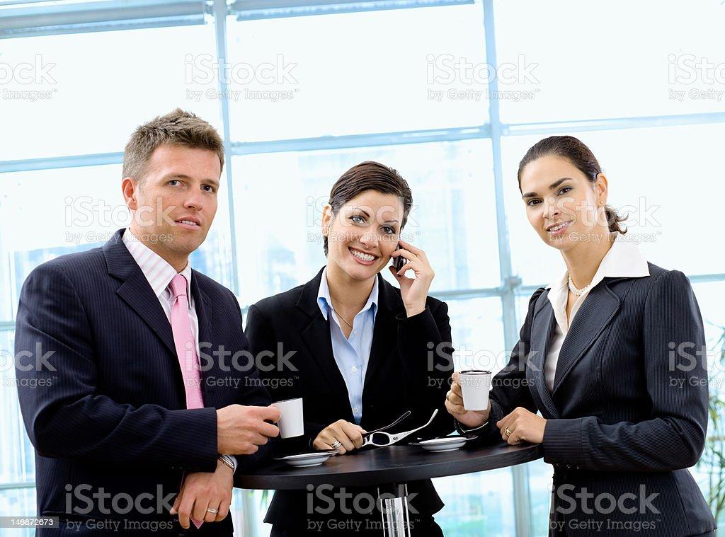 Businesspeople having coffee break royalty-free stock photo