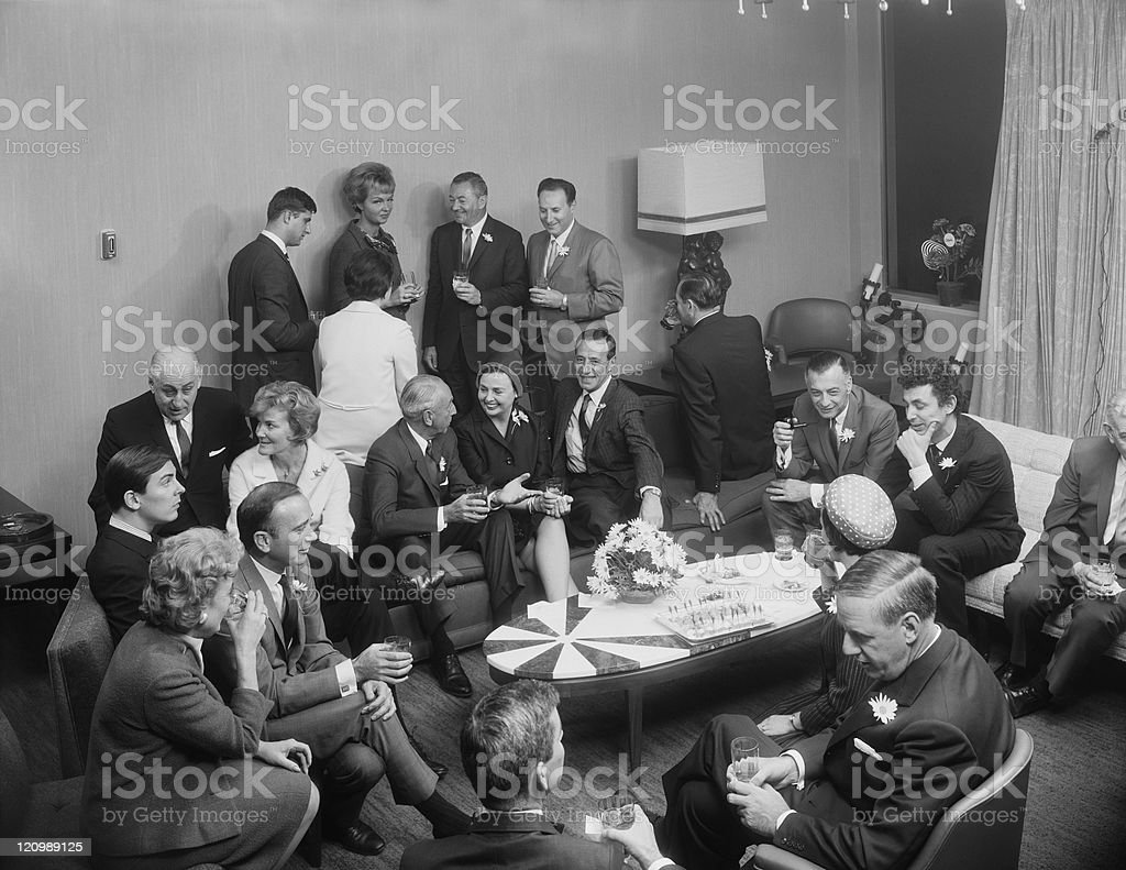 Businesspeople having drink in living room stock photo