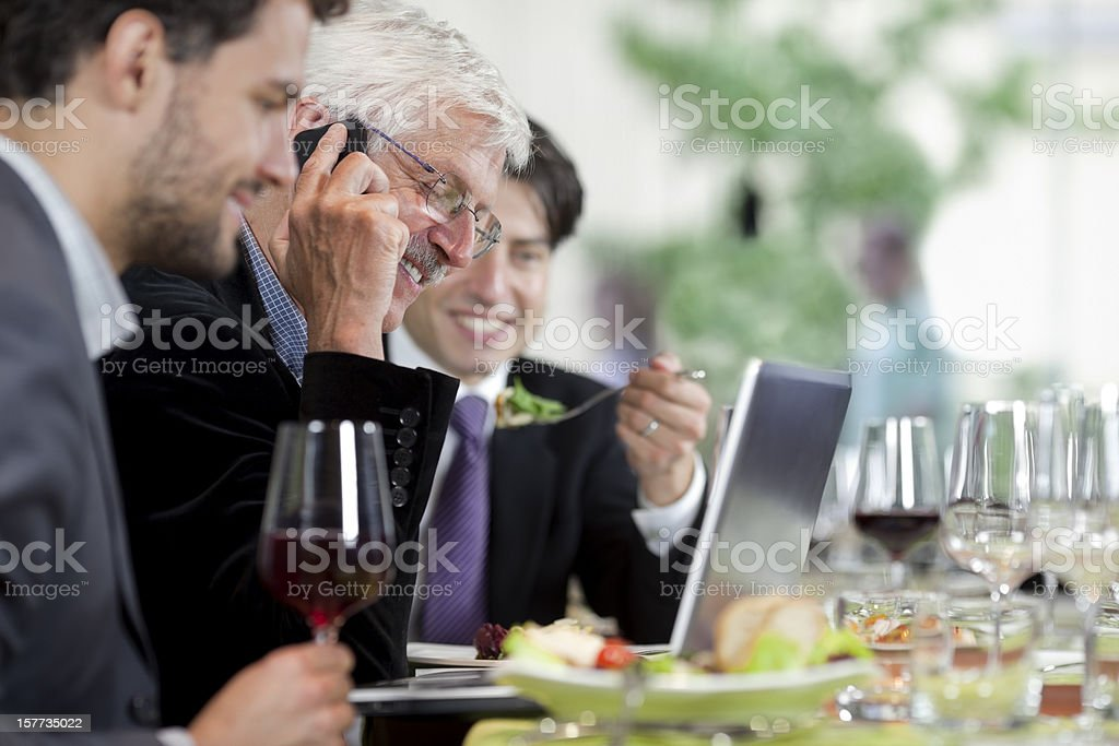 Businesspeople having lunch at restaurant royalty-free stock photo