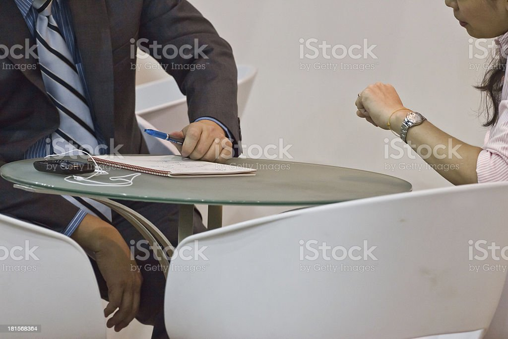 Businesspeople Having Meeting Around Table In Modern Office royalty-free stock photo