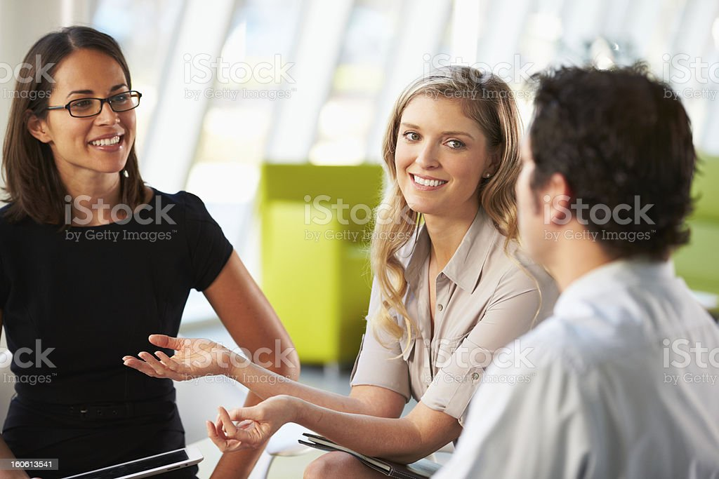 Businesspeople Having Meeting Around Table stock photo