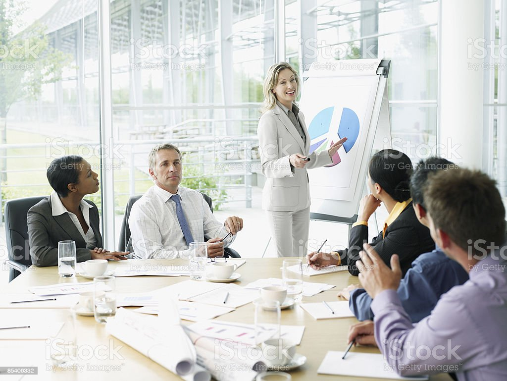 Businesspeople having meeting in conference room stock photo