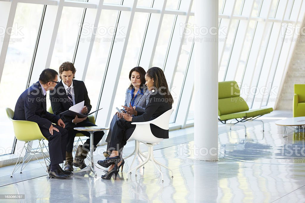 Businesspeople Having Meeting In Modern Office stock photo