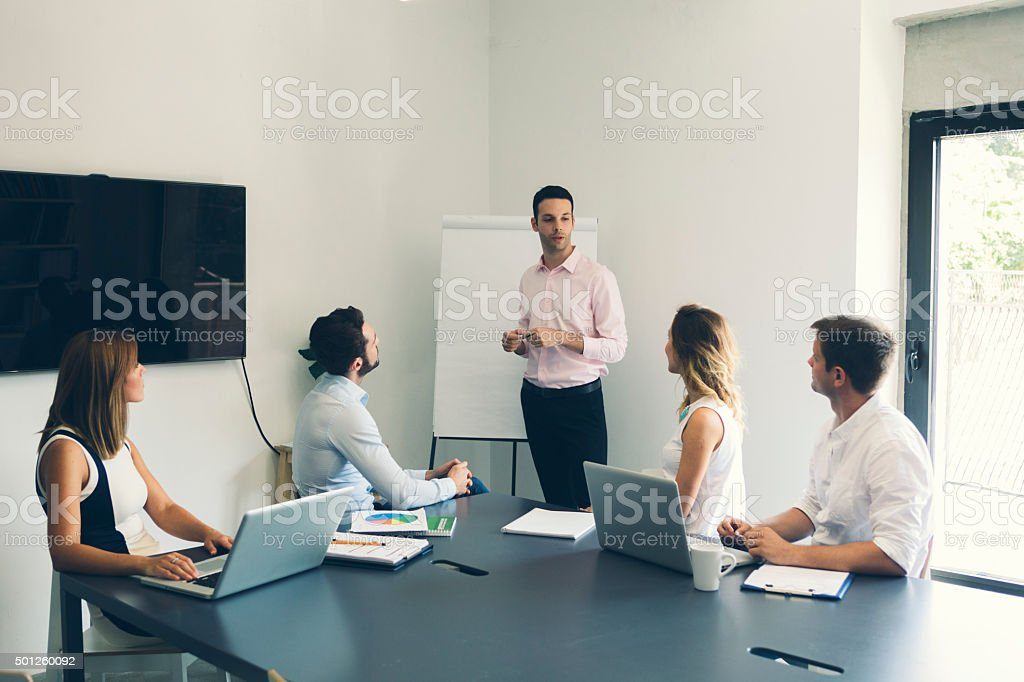 Businesspeople having meeting in office. stock photo