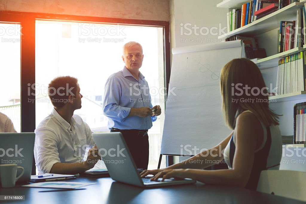 Businesspeople having meeting in their office. stock photo
