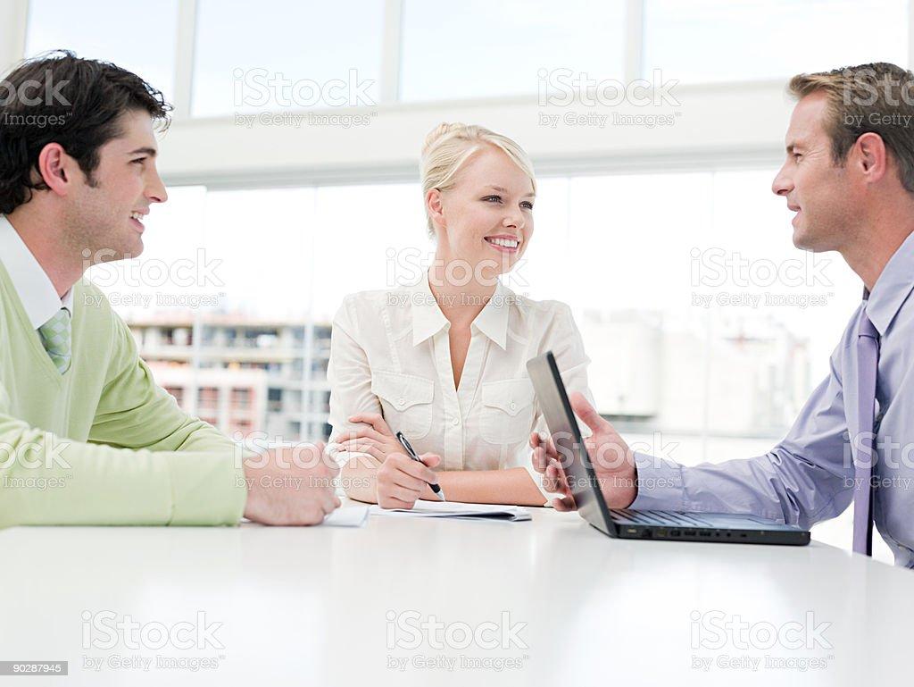 Businesspeople having meeting royalty-free stock photo