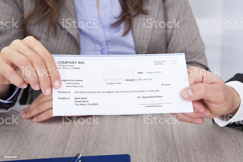 Businesspeople Holding Cheque stock photo