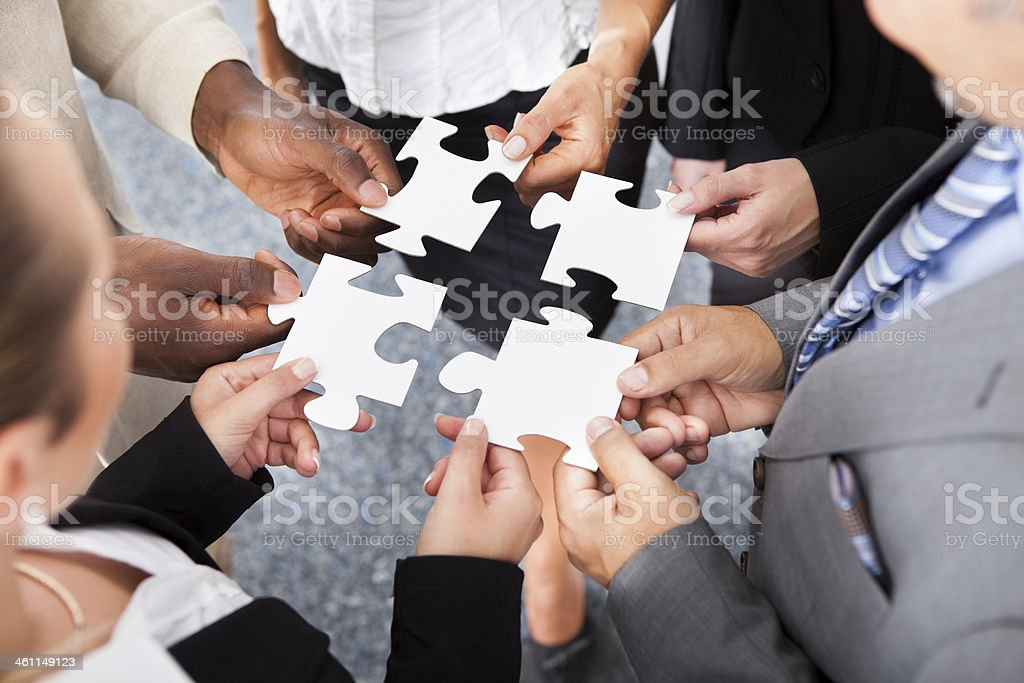 Businesspeople Holding Jigsaw Puzzle royalty-free stock photo